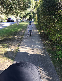 Kid riding bike in North Shore