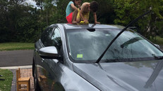 Washing the car with the kids