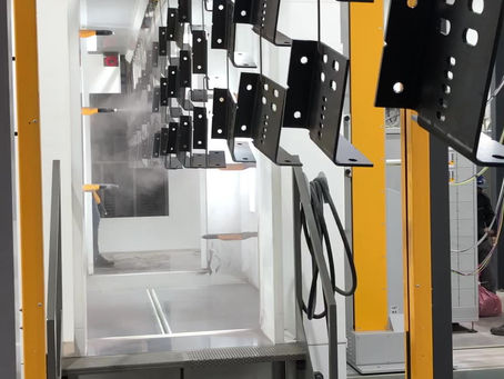 The new automated powder coating equipment at Heart-Fab is being tested.