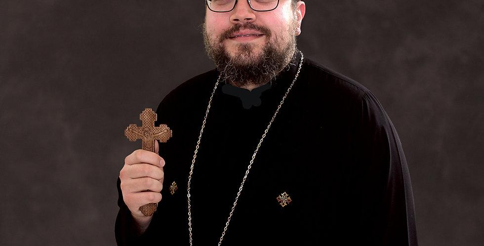 Fr. Karas Awad