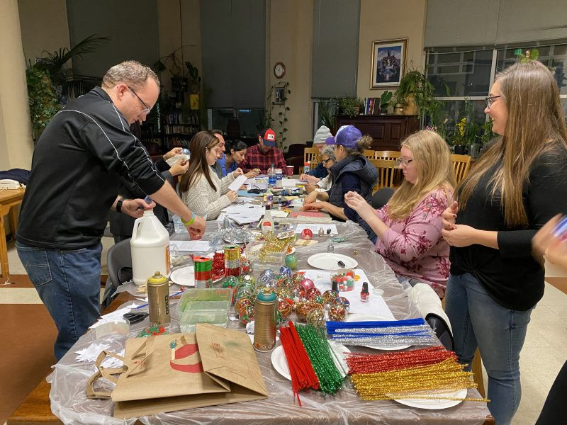Volunteers and residents decorate holiday ornaments (Photo Credit: YP Impact)
