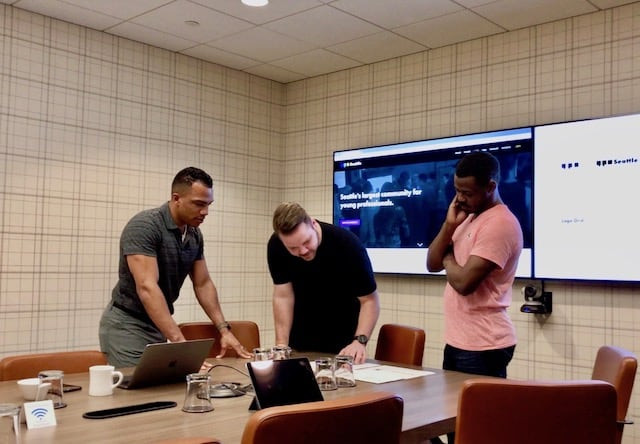 L to R: John Johnson, Troy Thomas (of a small studio) and Ahmad Corner (of YPGroup) discuss brand concepts.