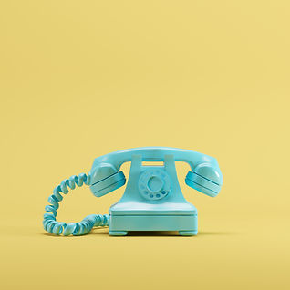 Blue vintage telephone on yellow pastel