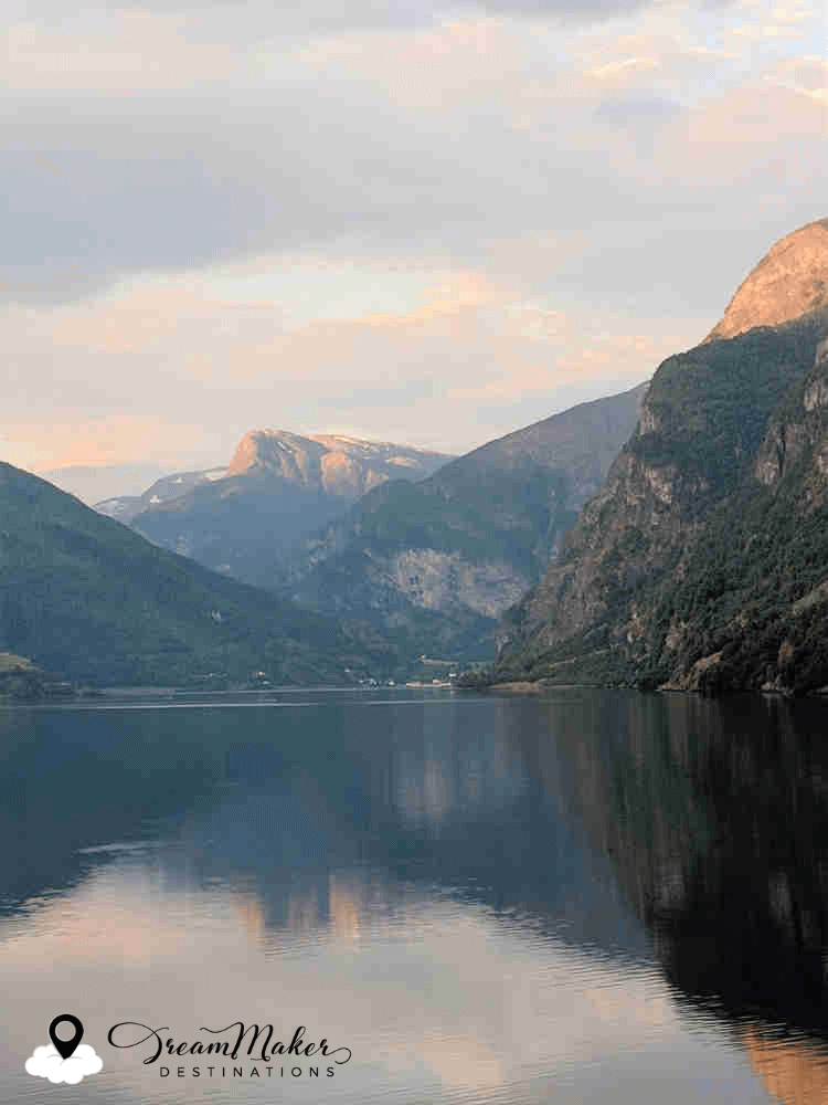 Scene from river in Norway. DreamMaker Destinations logo appears in lower left corner.