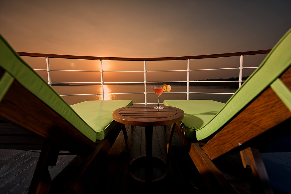 View from a river cruise deck overlooking the water at dusk.