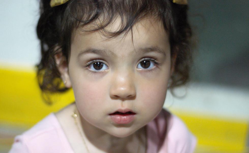 Alexia Kostic, 2, watches the entertainm