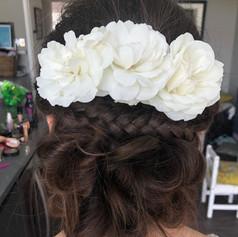 Braided bun with fresh roses