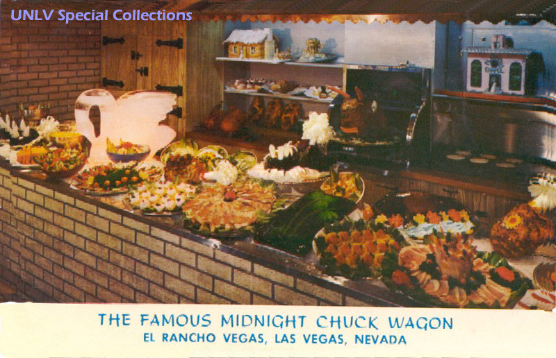 An image possibly from the 50s or 60s of the buffet at the El Rancho casino, featuring an ice swan, cold cuts, vegetables and an array of colorful platters.