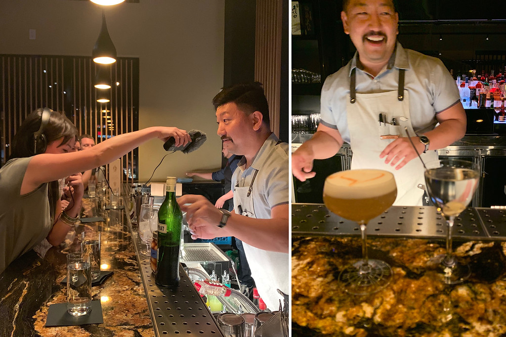 This is a two-photo collage: In the first photo, Kristy leans over the bar to record Sungjoon Koo explaining a cocktail. In the second photo, Sungjoon, wearing a canvas apron with leather straps, grins in the background while two cocktails sit in the foreground on the granite bar.