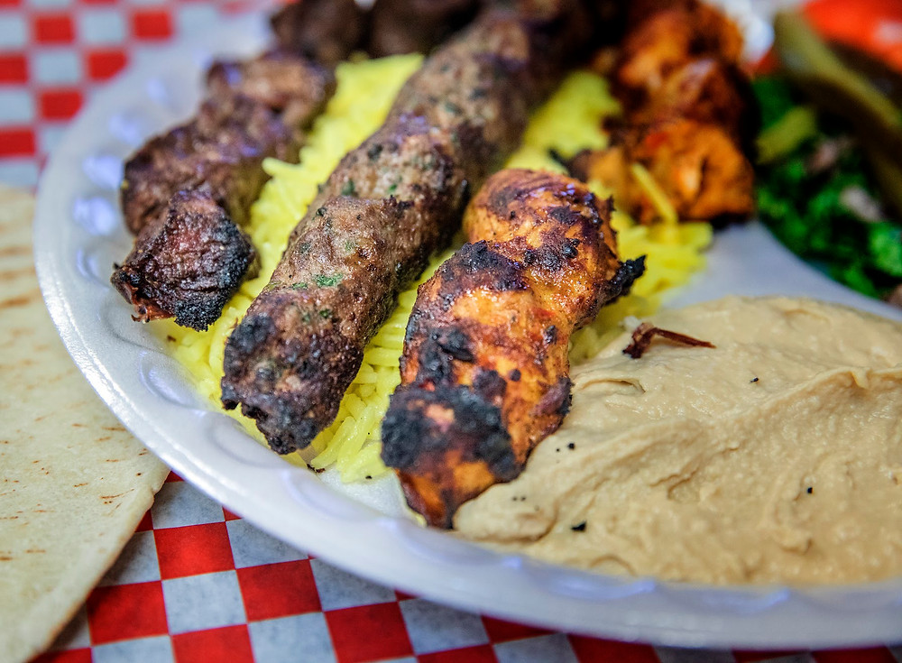 The combo plate from Afandi has beef and chicken skewers, plus a kefta (center), a kind of spiced lamb sausage.