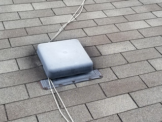 Roof repair in Whitby: removing the cables nailed on the shingles