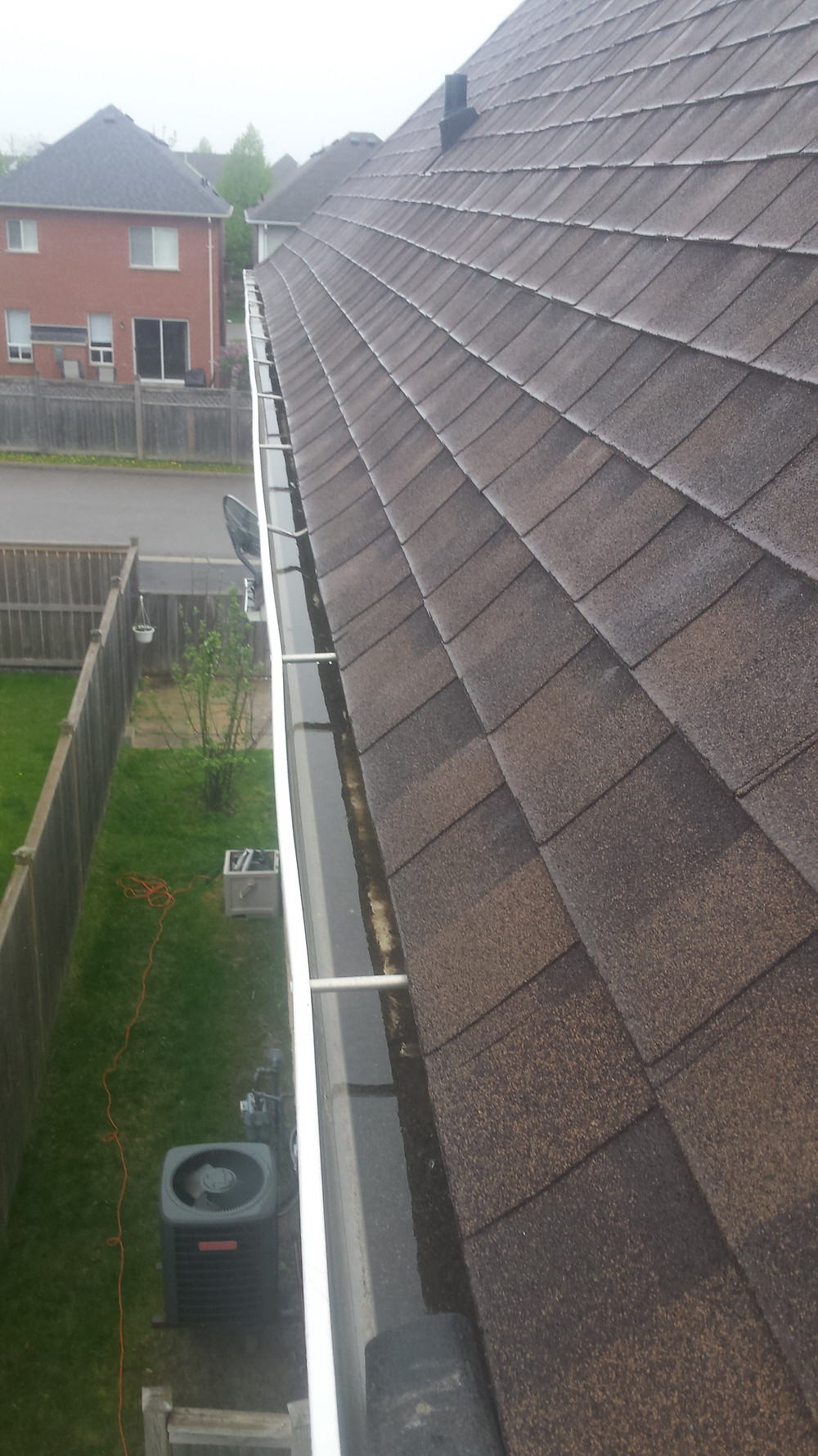 Eavestrough cleaning in progress in Whitby