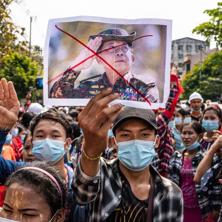 Opponents fight as supporters of Myanmar coup plan more protests