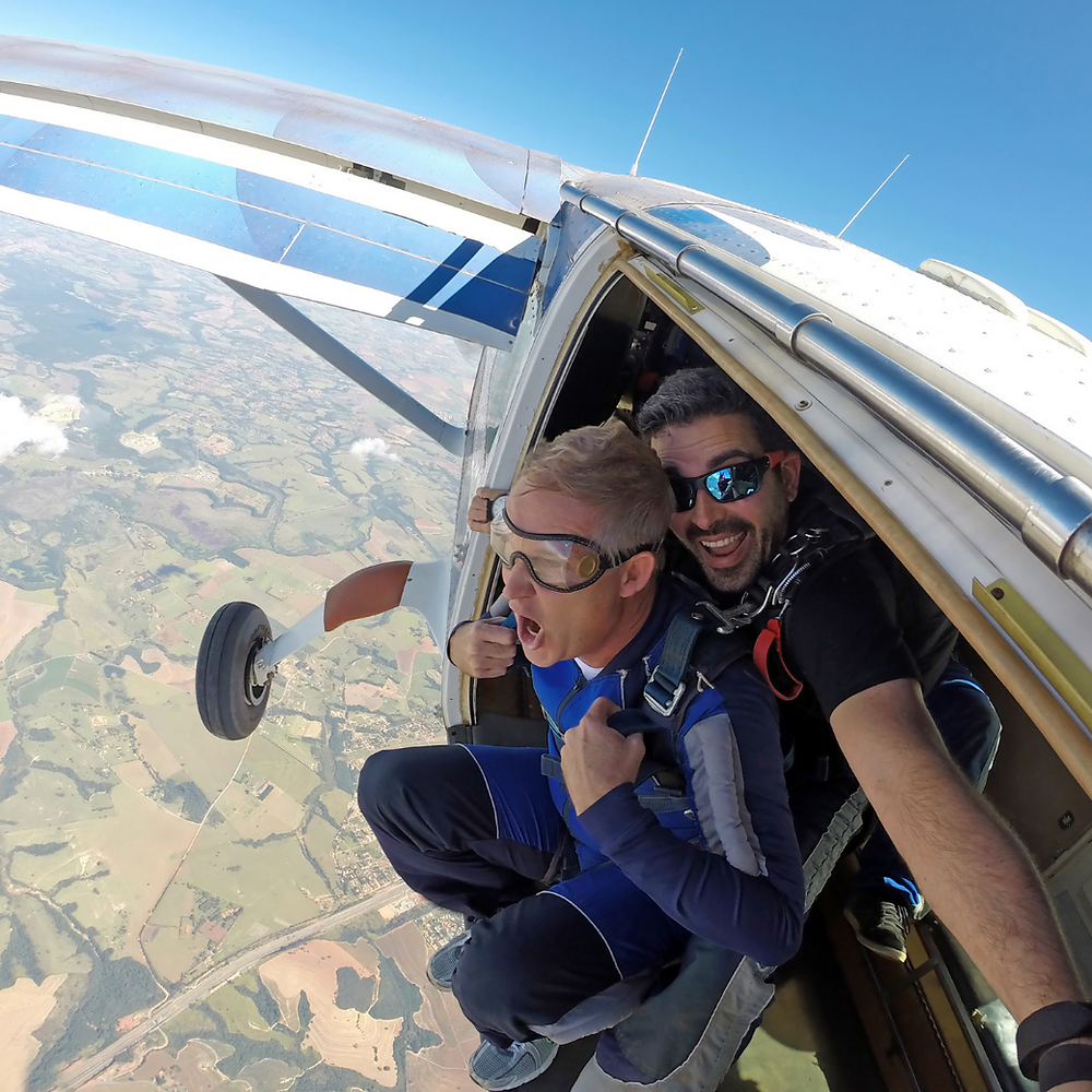 Two skydivers about to jump out of an airplane at 10,000 feet
