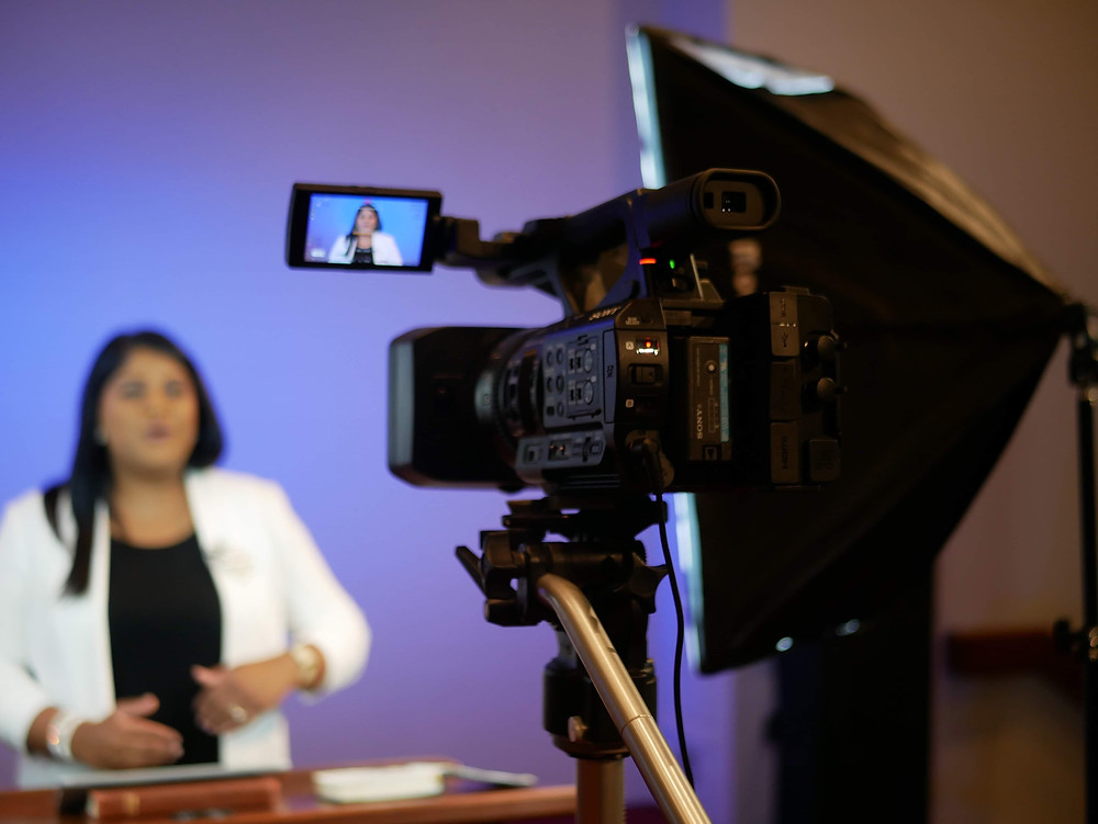 Pastor Lisa Outar being video taped by the new central camera