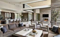 Great room with stone wall accents