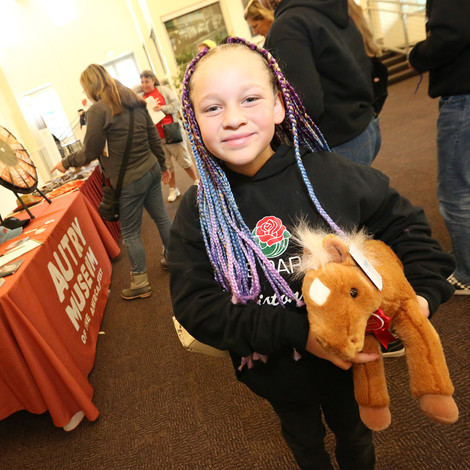 Young guest with Wells Fargo pony