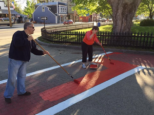 Michael Fulginiti of Cornish Trading Co., and Candace Gooch of At Once All Agog, paint the crosswalk. One of CAB's yearly, volunteer projects.