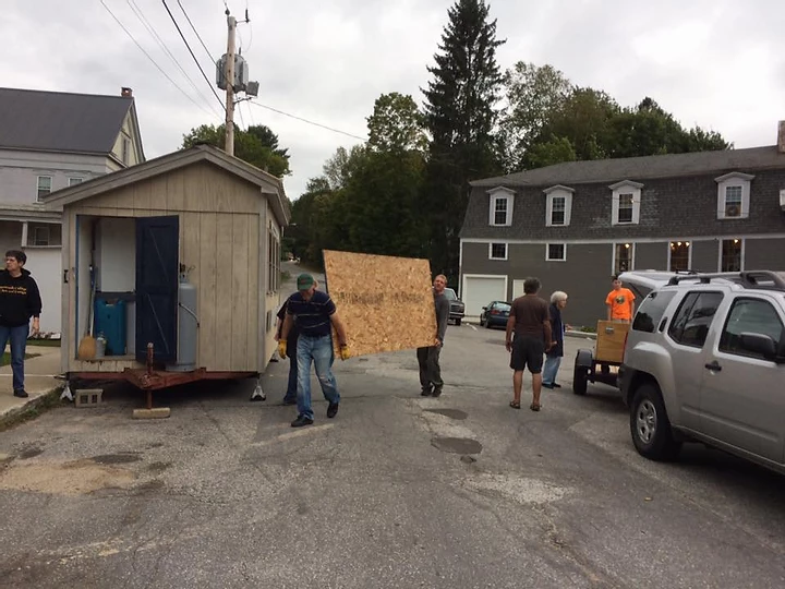 Former CAB President and Vice-President, Scott and Jason, carrying wood for what will be the stage during a festival. One of the many tasks for which volunteers are needed.