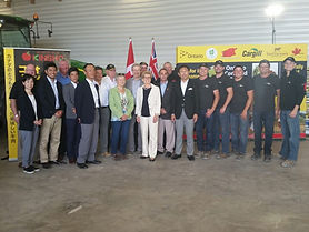 Ontario Corn Fed Beef Stakes a Claim in the Japanese Market.  Ontario Premier Kathleen Wynne, representatives from Japanese importer Prima and the Van Osch family are photographed while on the gate to plate Ontario Corn Fed Beef tour.