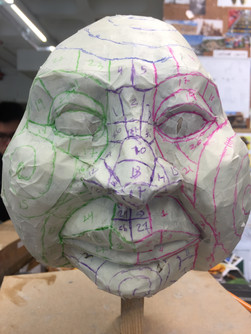 Sculpt patterned out with masking tape to scale up and made in Plastizote.