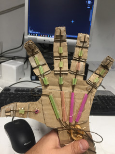 Moving Hand Maquette made from cardboard, straws and string.