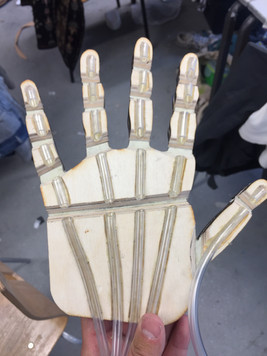 Final hand mechanisim made from laser cut ply, tubing and leather joints.