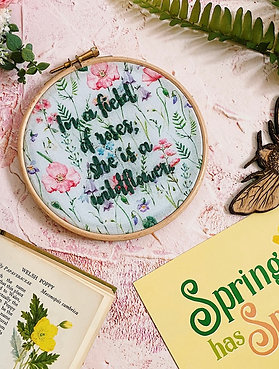 In A Field Of Roses, She Is A Wildflower Embroidery Hoop