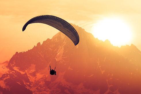 Sepia paraglide silhouette over Alps pea