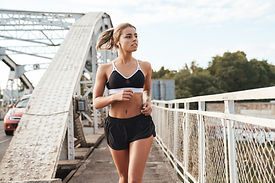 fitness-woman-outdoors-running-ZQ74BP6.j