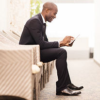Man reading newsletter on his tablet