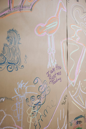 Details of I.AM's community arts guest wall.