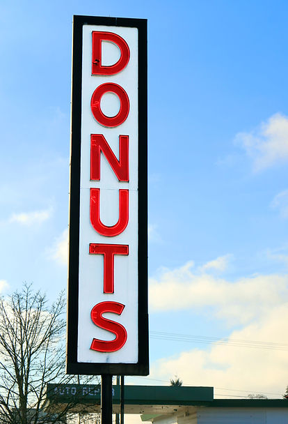 Original House of Donuts vintage neon sign outside our lakewood shop