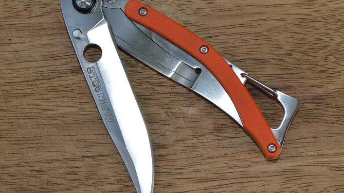 G10 סכין מטיילים עם קפיץ צד אלפין מתכת כסופה כתום