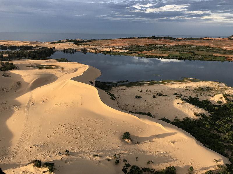 white sand dunes, lake