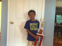 Dheenav with his trophy