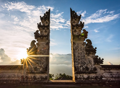 "Lempuyang Temple ""The Gate Heaven"" is an amazing spot to take your best photos with Mount Agung, sun and beautiful Bali temple in the background."