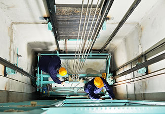 two male technician machinist worker at