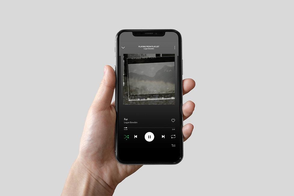 iPhone in Hand Mockup.jpg