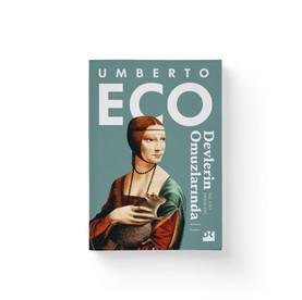 Umberto Eco - Devlerin Omuzlarında  Dogan Kitap