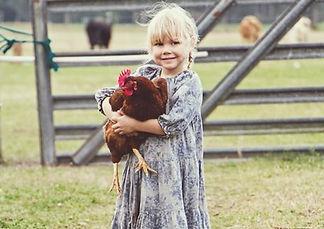 littlefarmgirlwithchicken.JPG
