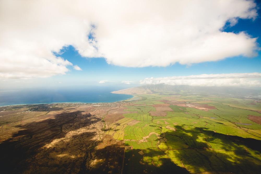 A contrast between a fertile and barren land under the blue sky