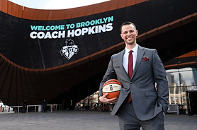 Sitting beside General Manager Jonathan Kolb, Hopkins could hardly withhold an enthusiastic grin through his introduction at the Liberty's new home arena, the Barclays Center in Brooklyn.