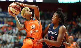 It's a one-point game in the last minute of the second quarter. The Connecticut Sun lead their best-of-five series 1-0 against the Los Angeles Sparks but are the trailing team in the game. Courtney Williams carries the ball over half court.