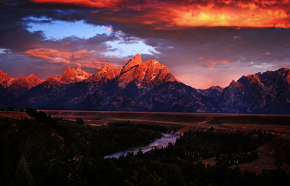 Fine art photography of The Grand Tetons as the sunrise hits the peaks.