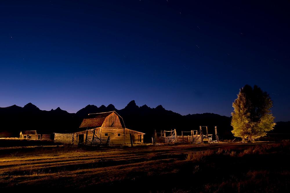 JOHN MOULTON BARN LIGHTPAINTED at night in Grand Tetons National Park