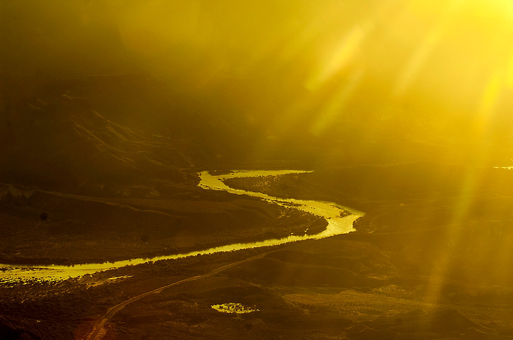 Rio Grande River reflects the setting sun between Mexico and the USA.