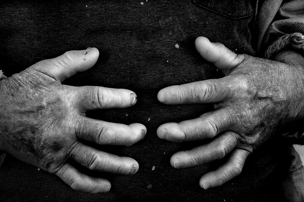 Fine art photography of hard working hands of a Waterman on the Texas Coast.