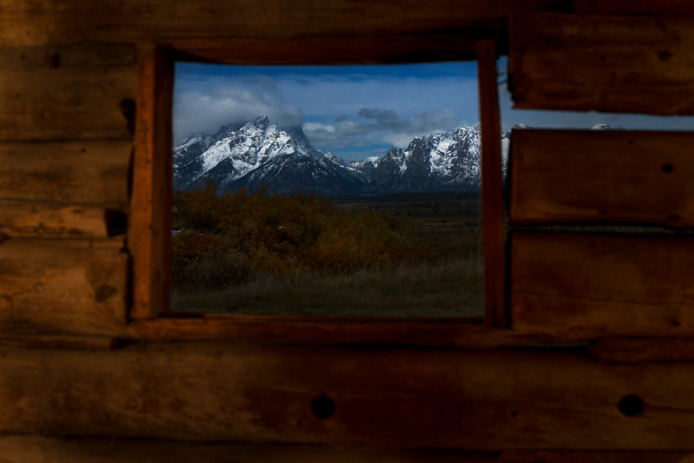 Night view from the Cunningham Cabin during a full moon in the Grand Tetons National Park.