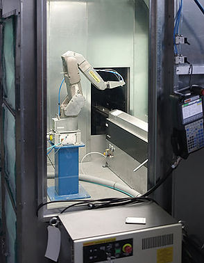ntegration of Fanuc PaintMate robot with indexing spindle conveyor